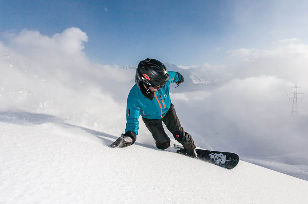 Man snowboarding down mountain in Verbier Switzerland